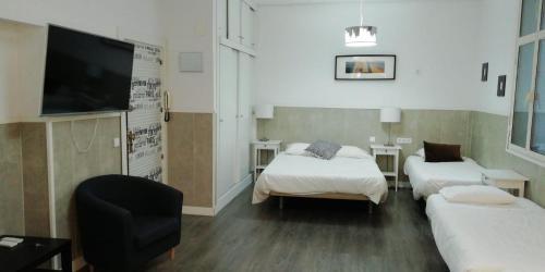 A bed or beds in a room at Apartamentos Sol Mayor