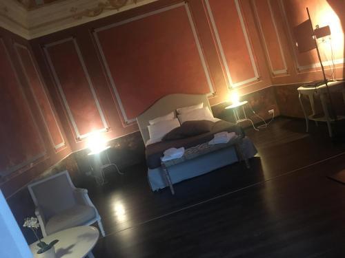 Letto o letti in una camera di Casa Brancaccio