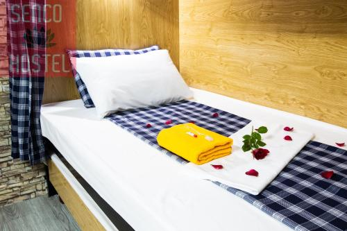 A bed or beds in a room at Senco Female Hostel