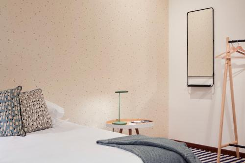 A bed or beds in a room at 60 Balconies Recoletos