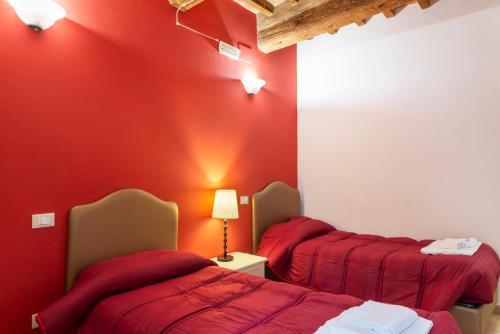Letto o letti in una camera di Porta Mazzini