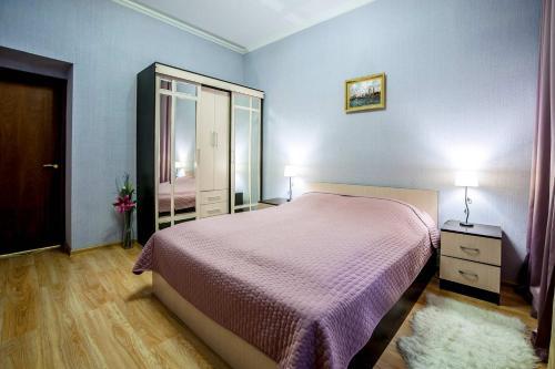 """Кровать или кровати в номере """"Невская перспектива"""""""