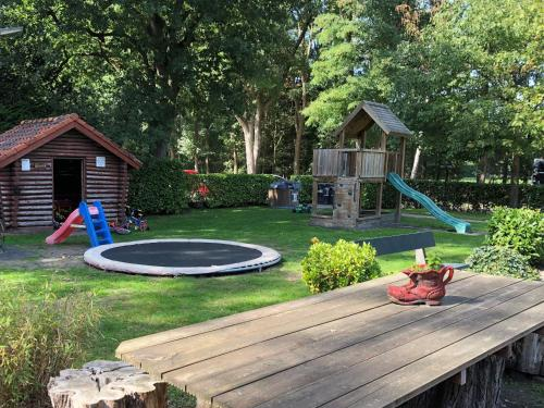 Children's play area at Boomgalows De Roestelberg