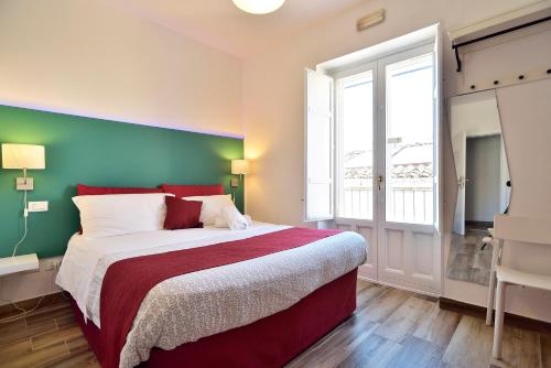 A bed or beds in a room at Modica Old Town Rooms