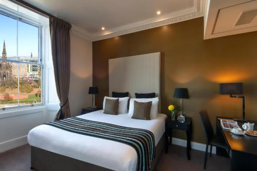 A bed or beds in a room at Fraser Suites Edinburgh
