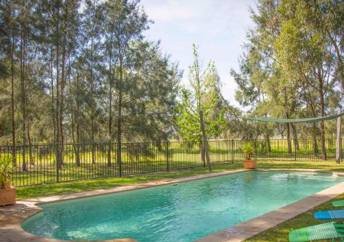 The swimming pool at or near Red Tractor Retreat