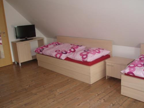Posteľ alebo postele v izbe v ubytovaní Aqua Spa Ganovce