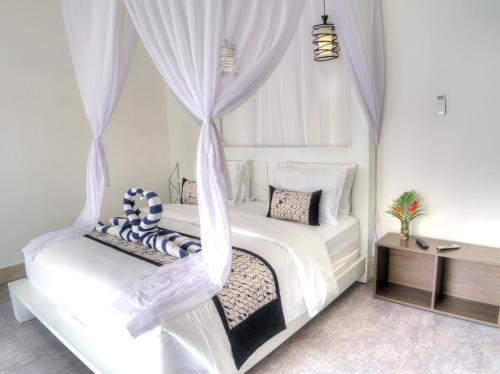 A bed or beds in a room at KyGunAya Villa
