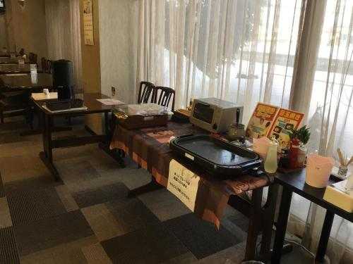 A restaurant or other place to eat at Hotel Tsubame Hills