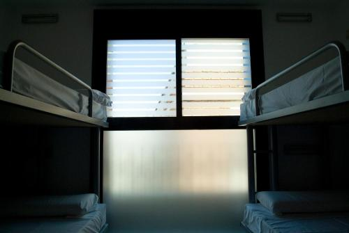 A bunk bed or bunk beds in a room at Center Valencia Youth Hostel