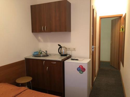Кухня или мини-кухня в Rinaldi Victory