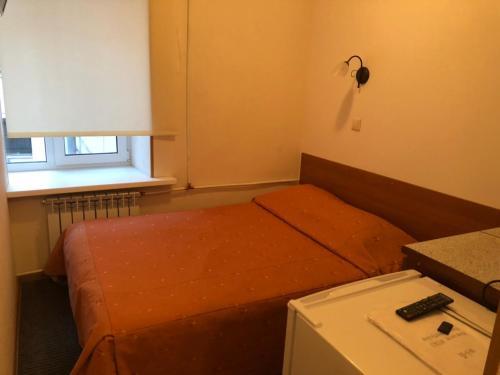 Кровать или кровати в номере Rinaldi Victory