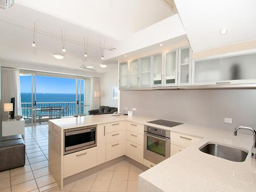 A kitchen or kitchenette at La Mer Sunshine Beachfront