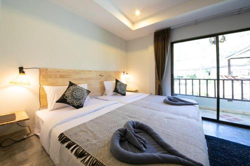 Кровать или кровати в номере Kata Bella Resort