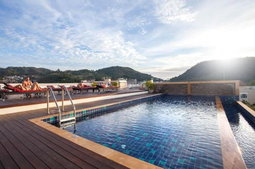 The swimming pool at or near Paripas Patong Resort