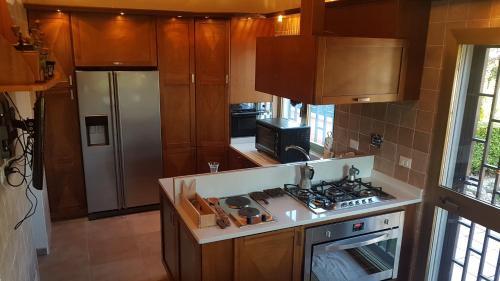 A kitchen or kitchenette at Olgiata 84