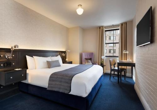 A bed or beds in a room at The Frederick Hotel Tribeca