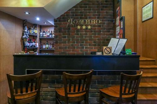 Лаундж или бар в Отель Домино
