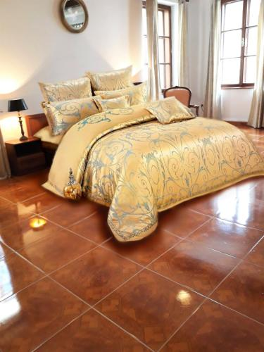 A bed or beds in a room at Belcanto Apartments