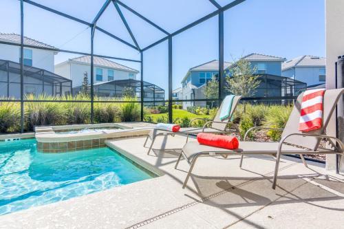 The swimming pool at or close to Enchanting Decor at Storey Lake Resort SL4714