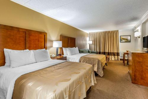 A bed or beds in a room at Quality Inn & Suites Oceanblock