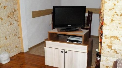 A television and/or entertainment center at Geto Apartment