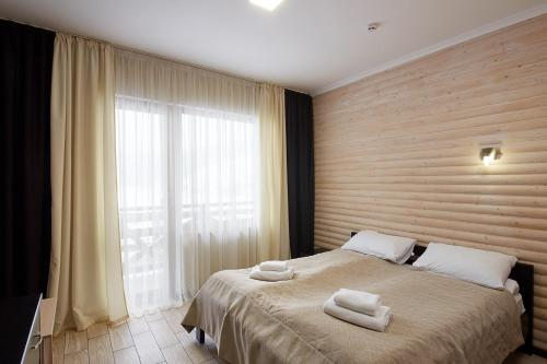 A bed or beds in a room at Zaporizʹka Sich
