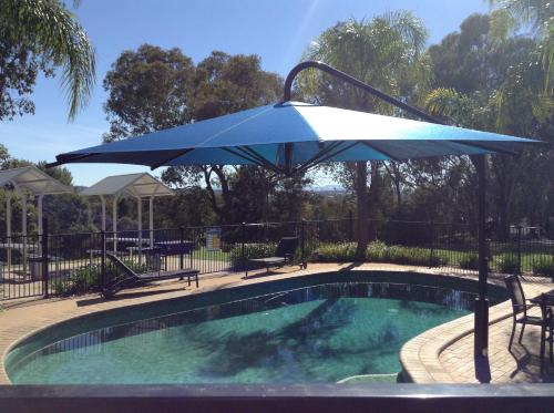 The swimming pool at or near Commercial Golf Resort