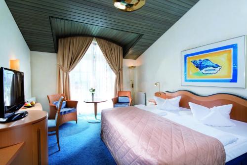 Ein Bett oder Betten in einem Zimmer der Unterkunft Kurhaus Sellin