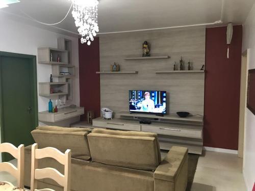 A seating area at Apartamento no Centro de Caxias do Sul