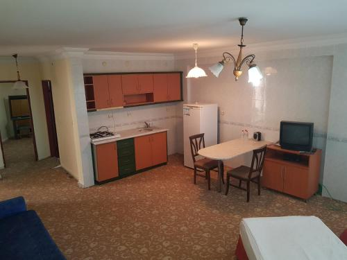 A kitchen or kitchenette at Anemurion Hotel