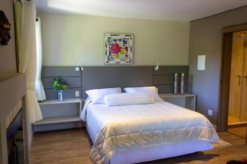 A bed or beds in a room at Hotel Canto Verde