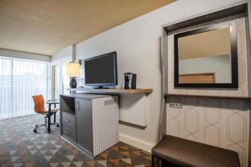 A television and/or entertainment center at Holiday Inn Denver East, an IHG Hotel