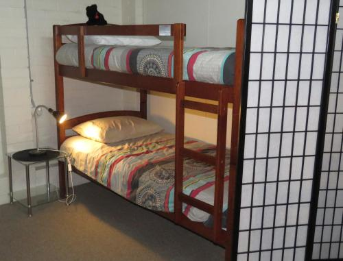A bunk bed or bunk beds in a room at Homestay Guest Suite