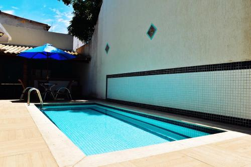 The swimming pool at or close to Flat's Refúgio Vip