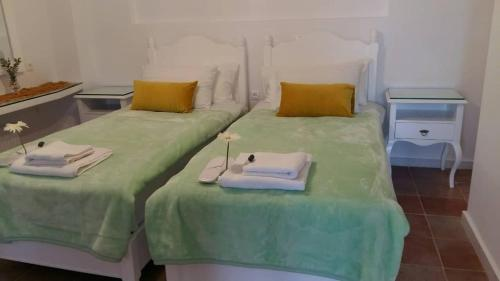 A bed or beds in a room at NN Luxury Room near Athens Airport