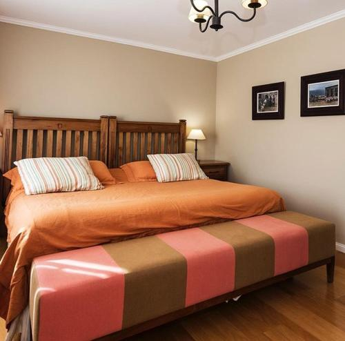 Una cama o camas en una habitación de Lo de Tomy