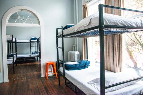 A bunk bed or bunk beds in a room at The Cambie Hostel Gastown