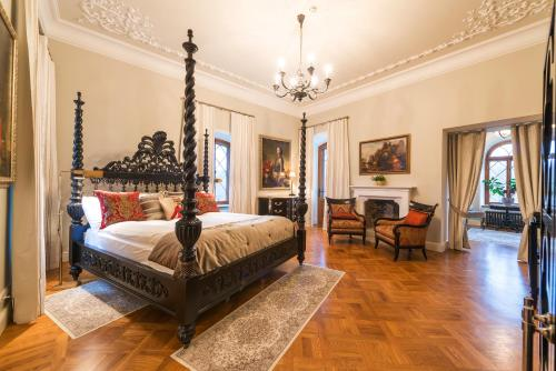 A bed or beds in a room at Keila-Joa Schloss Fall