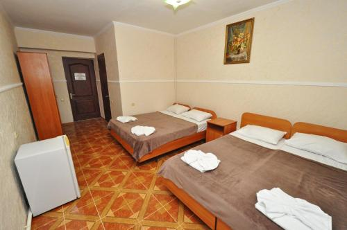 A bed or beds in a room at Guest House Alesha