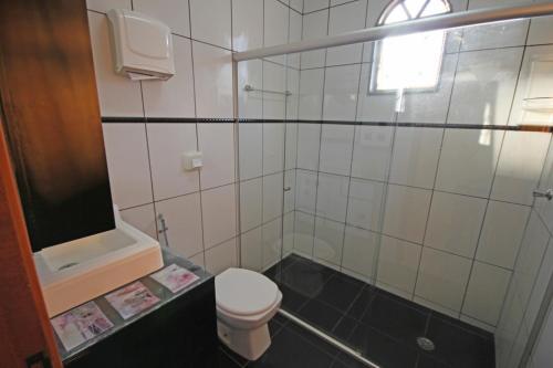 Um banheiro em Chácara Tangará