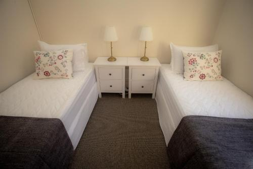 A bed or beds in a room at Helensburgh Hotel