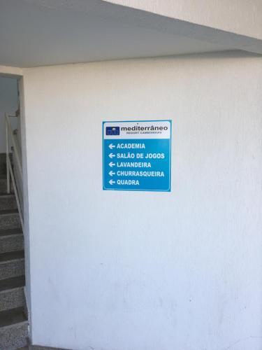 A certificate, award, sign, or other document on display at Apartamento linda vista, 200 metros da praia de camboinhas