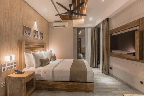 A bed or beds in a room at Samann Grand