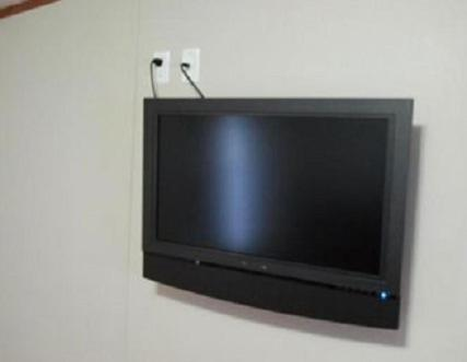 A television and/or entertainment center at Oasis Lodge - Carrizo Springs