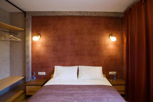 A bed or beds in a room at Parison