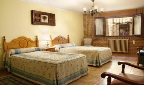 A bed or beds in a room at Casa Jacobea