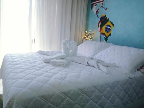 A bed or beds in a room at Vale Aventura