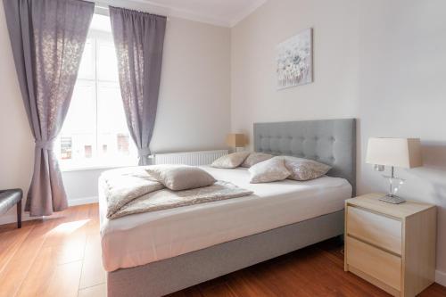 Łóżko lub łóżka w pokoju w obiekcie Babel Hostel