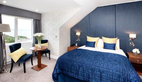 A bed or beds in a room at Shandon Hotel & Spa